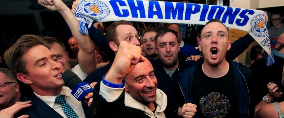 PHOTO: Leicester City fans celebrate in the Market Tavern in Leicester after seeing their side crowned English Premier League soccer champions following Tottenham Hotspurs 2-2 draw against Chelsea.