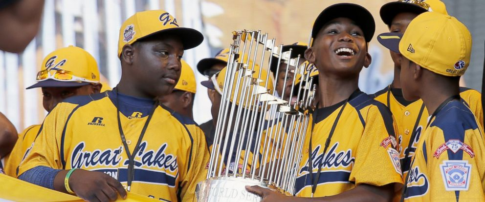 PHOTO: Members of the Jackie Robinson West Little League baseball team participate in a rally in Chicago celebrating the teams U.S. Little League Championship, Aug. 27, 2014.