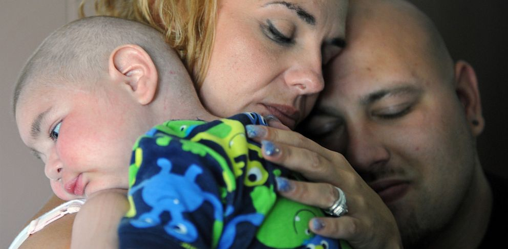 PHOTO: Christine Swidorsky holds her son, Logan Stevenson, 2, with her husband-to-be and Logans father Sean Stevenson, for a portrait on Tuesday, July 30, 2013 in their Jeannette, Pa., home.