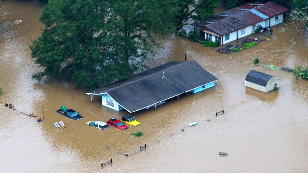 In this aerial photo, rescue officials and civilians alike work to pull people from their flooded homes along the flooded Tangipahoa River near Amite, Independence, Tickfaw and Robert, Louisiana, Aug. 13, 2016.