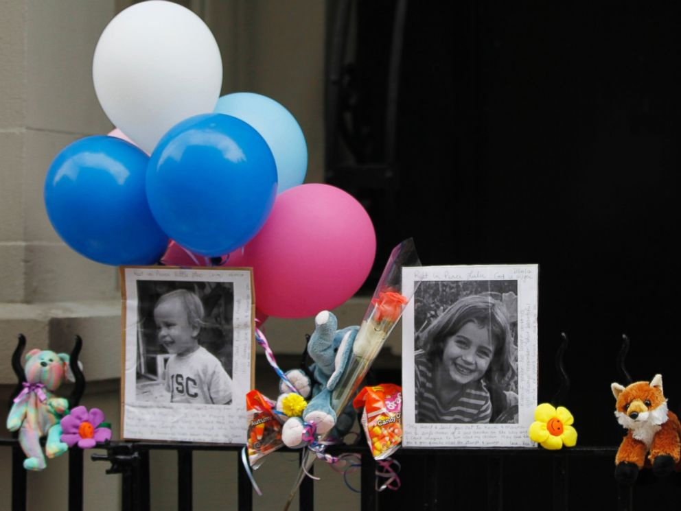 PHOTO: Photographs of six-year-old Lucia Krim and her 2-year-old brother, Leo, are displayed alongside balloons and stuffed animals at a memorial outside the apartment building were they lived in New York, Oct. 27, 2012.