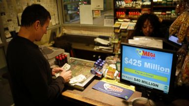 PHOTO: A customer counts out his money to buy Mega Millions lottery tickets at a newsstand, Dec. 13, 2013, in Philadelphia.