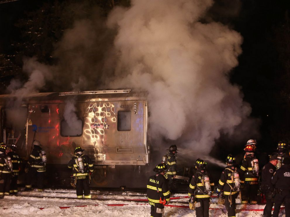 PHOTO: Firefighters work the scene of a collision between a Metro-North Railroad passenger train and a vehicle in Valhalla, N.Y., Feb. 3, 2015.