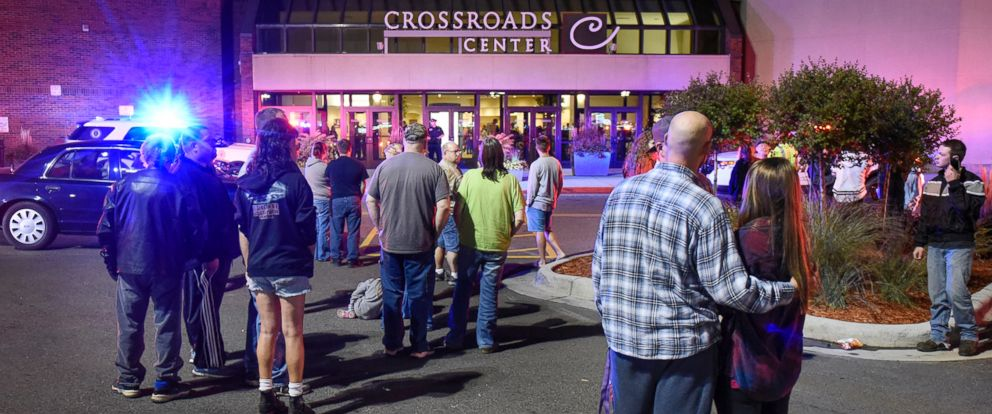 PHOTO: People stand near the entrance on the north side of Crossroads Center shopping mall in St. Cloud, Minnesota, Sept. 17, 2016.