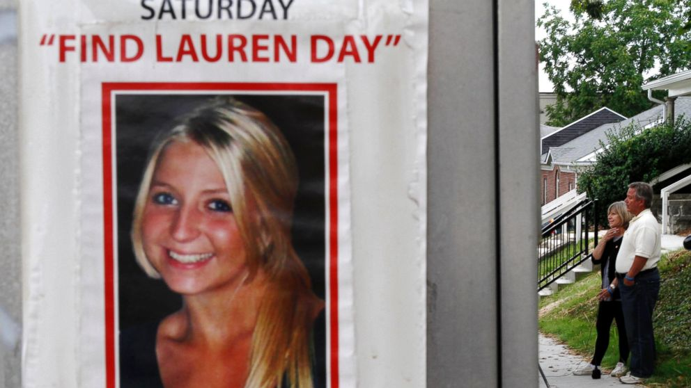 Charlene and Robert Spierer speak to reporters near a poster alerting people to their missing daughter, Lauren, August 15th, 2011 in Bloomington, Ind.