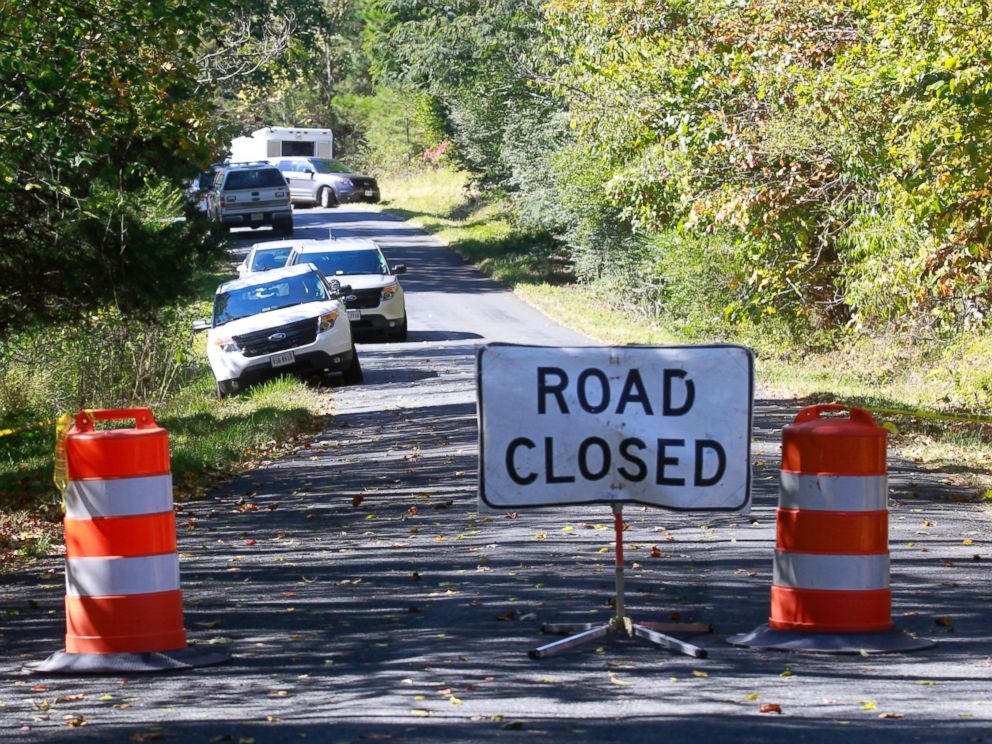 PHOTO: A road closed sign blocks traffic as authorities search a rural area where human remains were discovered in Albermarle County, Va., Oct. 19, 2014.