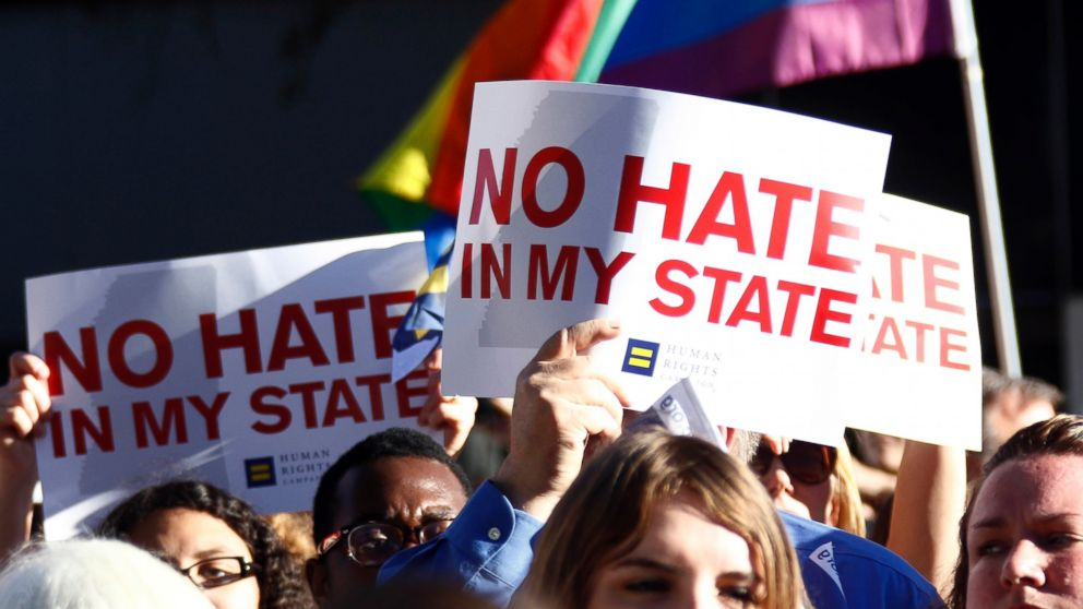Protesters call for Mississippi Gov. Phil Bryant to veto House Bill 1523, which they says will allow discrimination against LGBT people, during a rally outside the Governor's Mansion in Jackson, Miss., April 4, 2016.