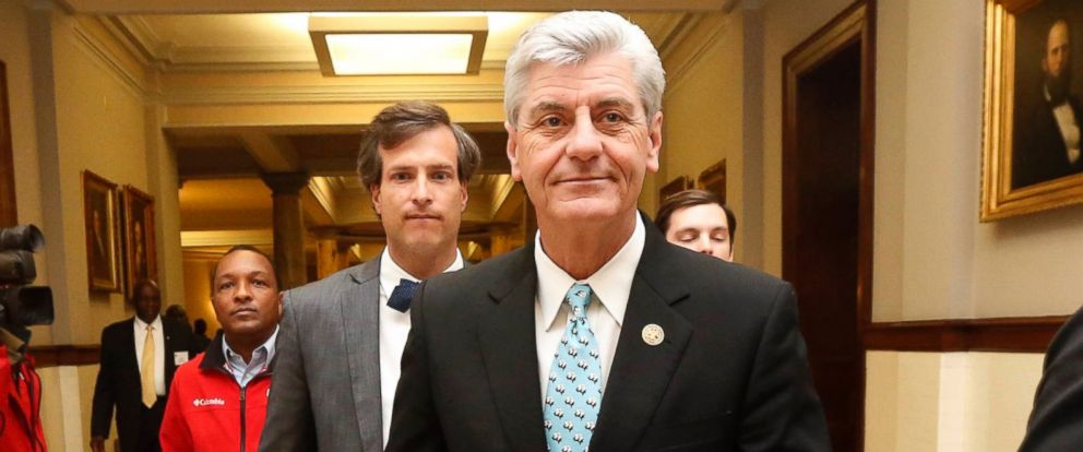 PHOTO: Gov. Phil Bryant walks on his way to a meeting of a youth jobs program board, at the Capitol in Jackson, Miss., April 1, 2016.