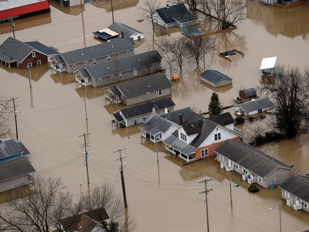 PHOTO: In this aerial photo, homes are surrounded by floodwater, Dec. 30, 2015, in Pacific, Mo.