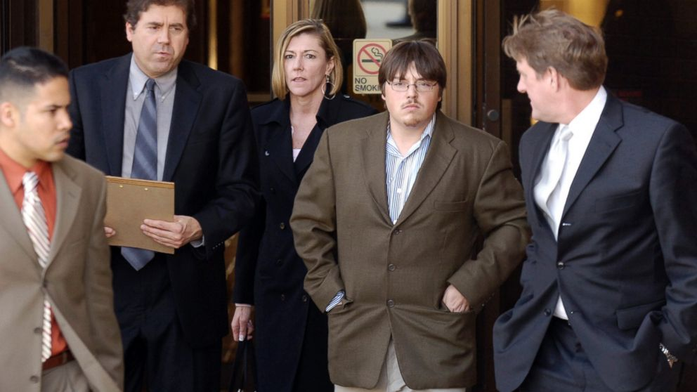 Defense attorney John B. Schisler, second from left, and his client Mitchell Johnson, 23, second from right, walk out of the Federal Building during a lunch break from Johnson's trial, Jan. 29, 2008, in Fayetteville, Ark.