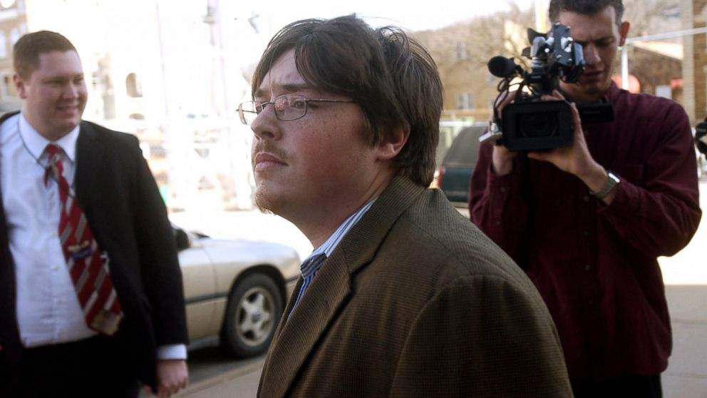 Jonesboro school shooter Mitchell Johnson, center, walks past members of the media during a lunch break from his trial at the Federal Building, Jan. 29, 2008 in Fayetteville, Ark.