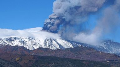 PHOTO: Smoke billows from the Mount Etna, Europes tallest active volcano, in Sicily, Nov. 23, 2013.