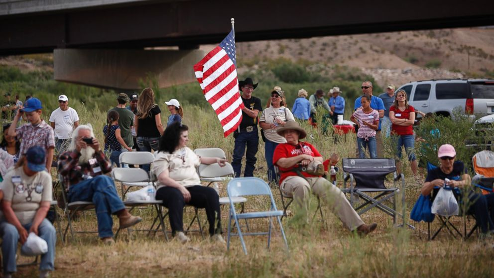 People gather along the Virgin River during a rally in support of Cliven Bundy near Bunkerville, Nev. Friday, April 18, 2014.