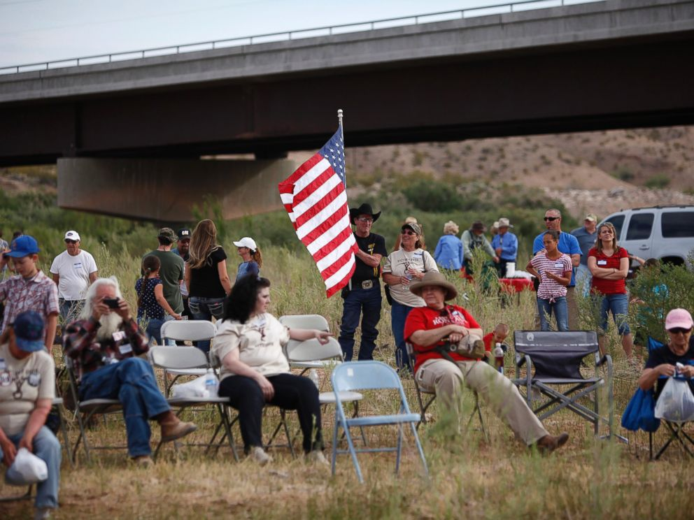 PHOTO: People gather along the Virgin River during a rally in support of Cliven Bundy near Bunkerville, Nev. Friday, April 18, 2014.