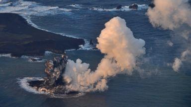 PHOTO: Smoke billows from a new island off the coast of Nishinoshima