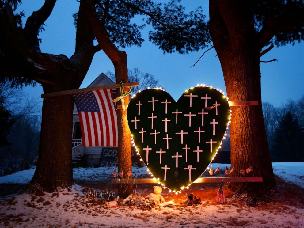 PHOTO: In this Dec. 14, 2013 file photo, a makeshift memorial with crosses for the victims of the Sandy Hook massacre stands outside a home in Newtown, Conn.