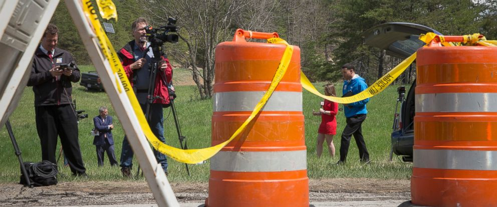 PHOTO: Media personnel stand on Union Hill Road at the perimeter of a crime scene, April 22, 2016, in Pike County, Ohio.