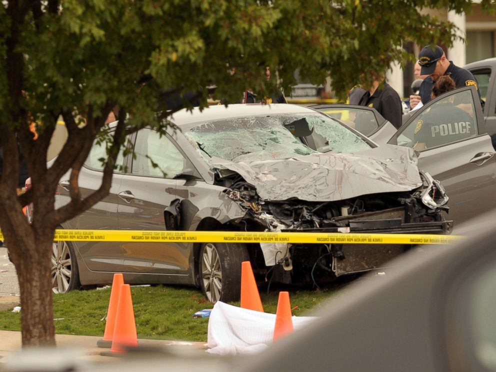 PHOTO:Police investigate a damaged car after the vehicle crashed into a crowd of spectators during the Oklahoma State University homecoming parade, causing multiple injuries, Oct. 24, 2015, in Stillwater, Oka.