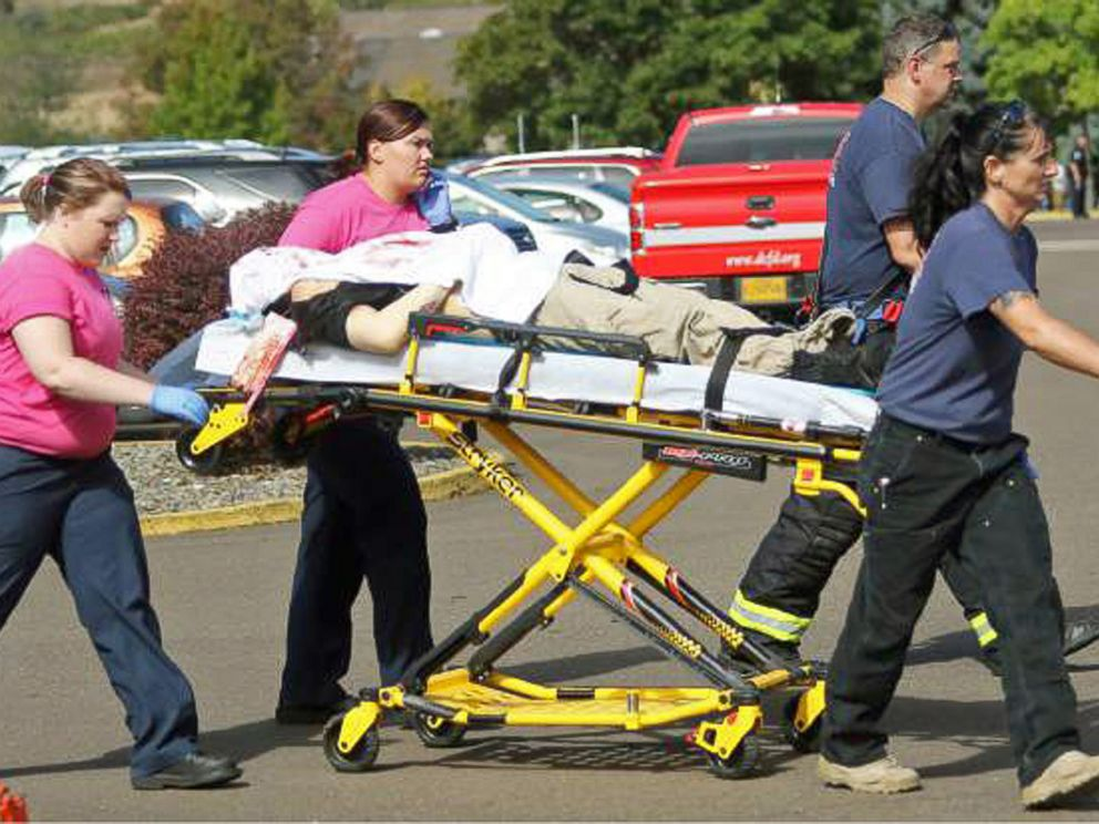 PHOTO: Authorities carry a shooting victim away from the scene after a gunman opened fire at Umpqua Community College in Roseburg, Ore., Oct. 1, 2015.