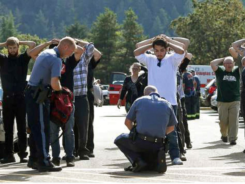 PHOTO: Police search students outside Umpqua Community College in Roseburg, Ore., Oct. 1, 2015, following a deadly shooting at the college.