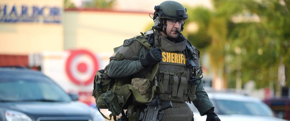 PHOTO: An Orange County Sheriffs Department SWAT member arrives to the scene of a fatal shooting at Pulse Orlando nightclub in Orlando, June 12, 2016.