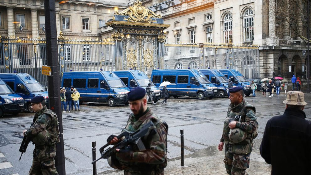 French soldiers patrol outside the Paris hall of Justice, March 30, 2016, while Frenchman Reda Kriket is being questioned by a magistrate.
