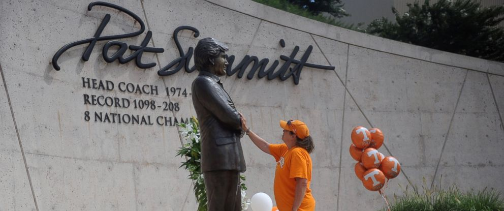 PHOTO: Teresa Olive, of Knoxville, Tenn., touches a statue of Pat Summitt as she pays her respects at the University of Tennessee, June 28, 2016, in Knoxville, Tenn.