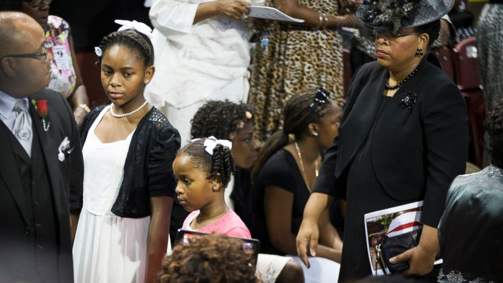 Sen. Clementa Pinckney's wife Jennifer Pinckney, right, and daughters Eliana, left, and Malana walk in for his funeral service, June 26, 2015, in Charleston, S.C.