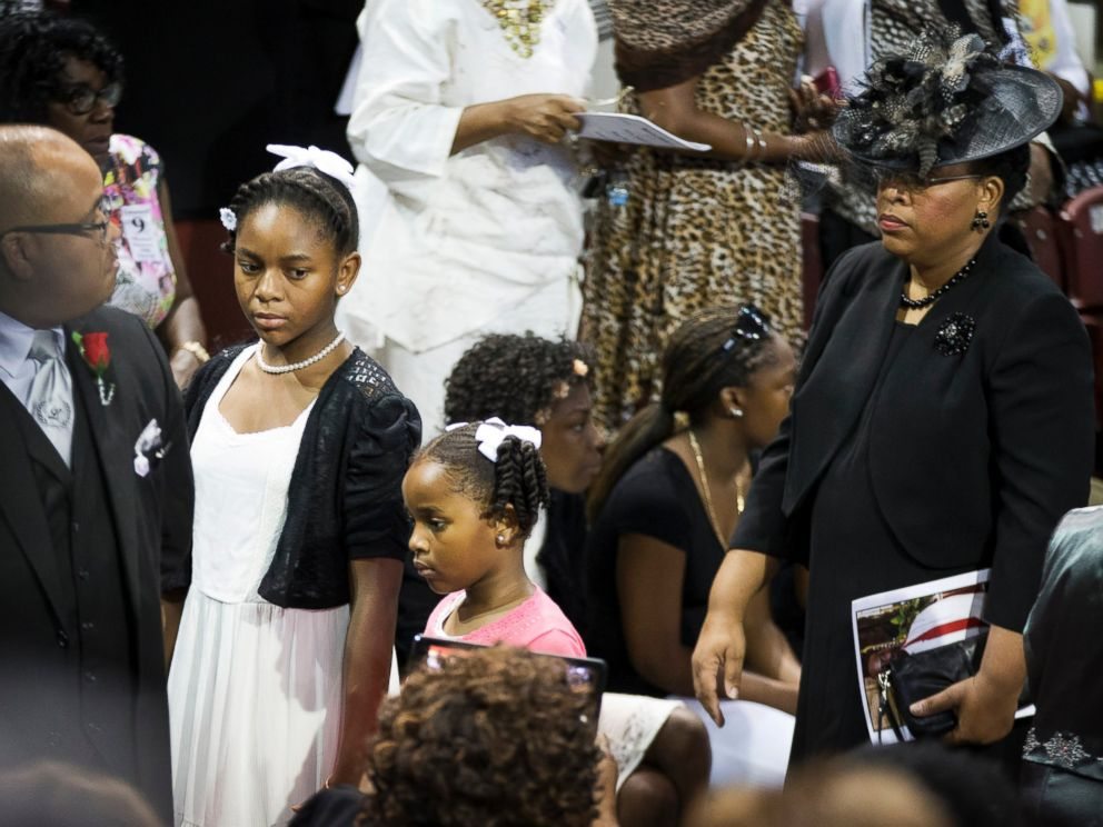 PHOTO: Sen. Clementa Pinckneys wife Jennifer Pinckney, right, and daughters Eliana, left, and Malana walk in for his funeral service, June 26, 2015, in Charleston, S.C.