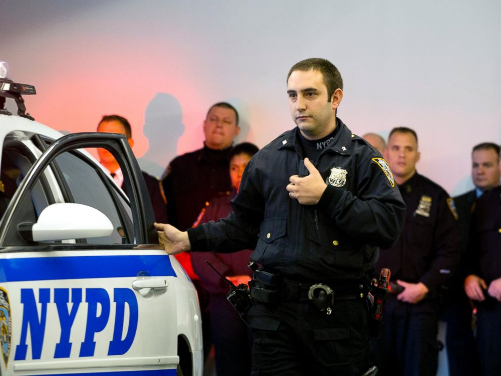 PHOTO: New York Police Department officer Joshua Jones turns on a body camera attached to his chest during a traffic stop training demonstration for the media, Dec. 3, 2014 in New York.