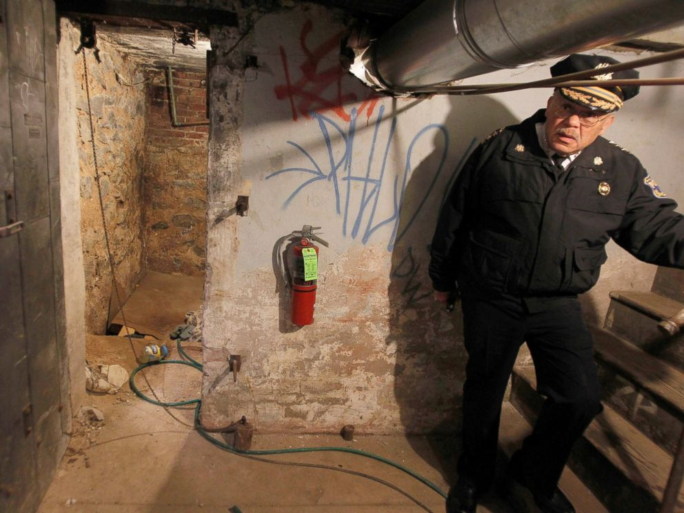 PHOTO: Police Commissioner Charles Ramsey stands by the entrance to the dank basement room in Philadelphia where four weak and malnourished mentally disabled adults were found locked inside, Oct. 17, 2011.