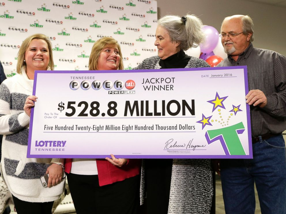 PHOTO: Rebecca Hargrove, second from right, president and CEO of the Tennessee Lottery, presents a ceremonial check to John Robinson, right; his wife, Lisa, second from left; and their daughter, Tiffany, left; on Jan. 15, 2016, in Nashville, Tenn.