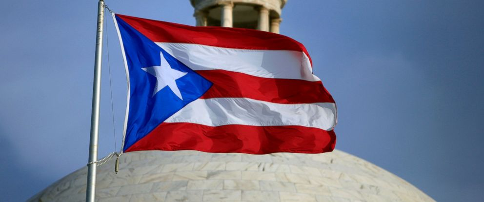 PHOTO: The Puerto Rican flag flies in front of Puerto Ricos Capitol as in San Juan, Puerto Rico, July 29, 2015.