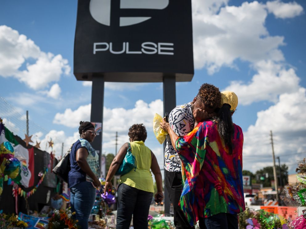 PHOTO: Wayne Dominici, 23, cries on the shoulder of his aunt, Ada Dominici, July 12, 2016, at a memorial outside Pulse, the gay nightclub where a shooter killed 49 people in Orlando, Florida.