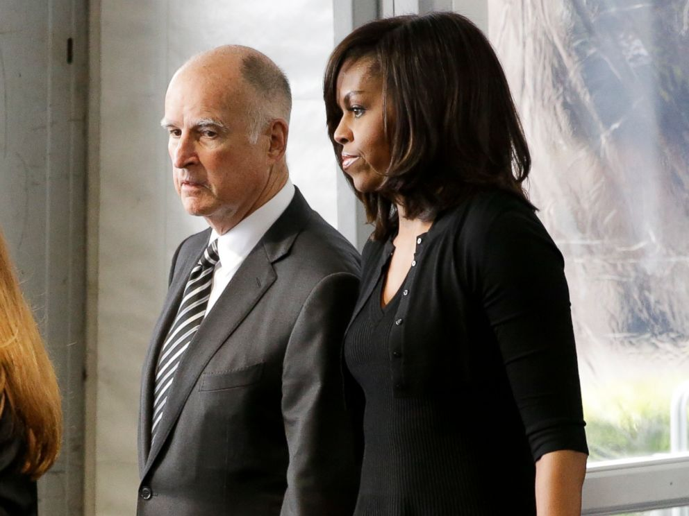 PHOTO: California Gov. Jerry Brown, left, and first lady Michelle Obama arrive at the funeral service for Nancy Reagan at the Ronald Reagan Presidential Library, March 11, 2016 in Simi Valley, Calif.