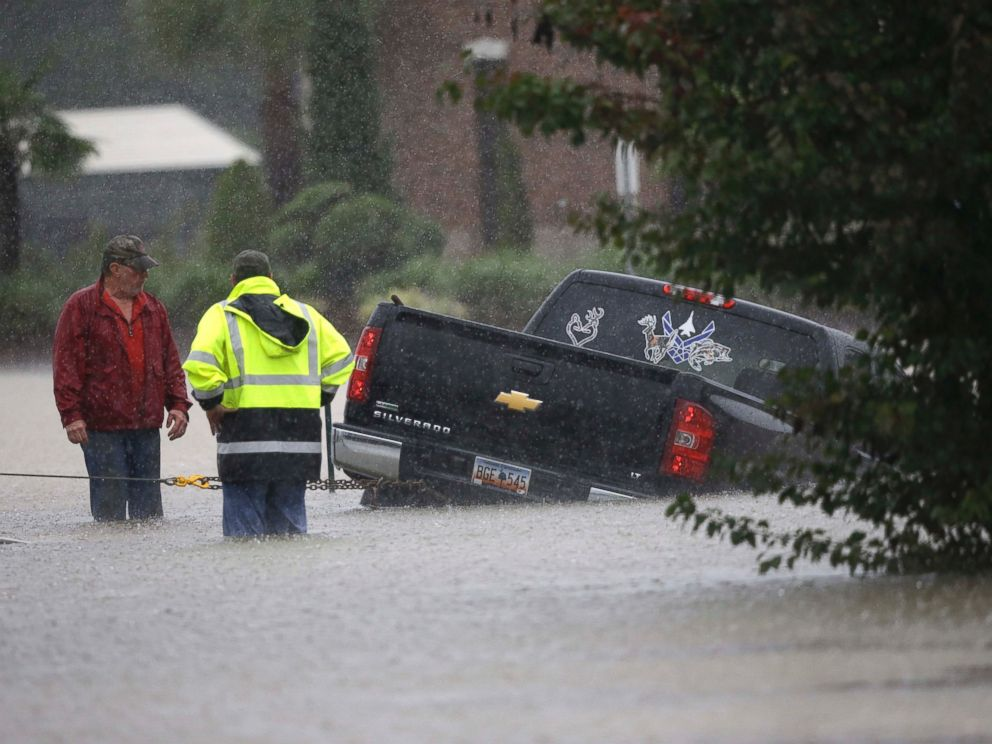 PHOTO: A tow-truck operator assists a stranded motorist during flash flooding in Florence, S.C., Oct. 4, 2015, as heavy rain continues to cause widespread flooding in the state.