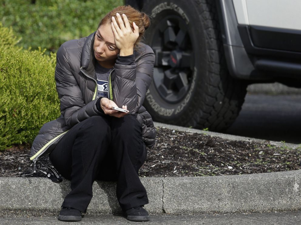 PHOTO: A woman waits on a curb at a church, where students were taken following a shooting at Marysville Pilchuck High School in Marysville, Wash. on Oct. 24, 2014.