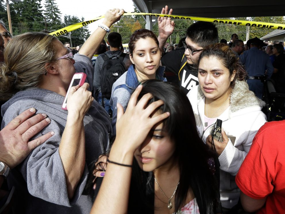 PHOTO: Parents and students move under police tape at a church, where students were taken following a shooting at Marysville Pilchuck High School in Marysville, Wash. on Oct. 24, 2014.