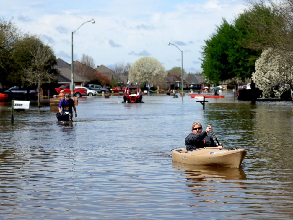 Golden Meadows resident Sabrina Langley canoes to the road to leave the flooded subdivision in Bossier Parish, La., March 10, 2016.