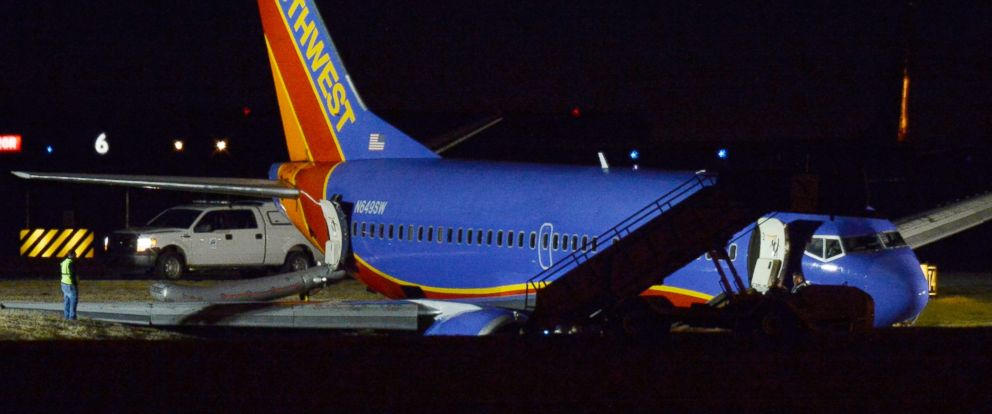 PHOTO: A Southwest Airlines plane rests on the ground after skidding off the runway at Nashville International Airport, Dec. 15, 2015, in Nashville.