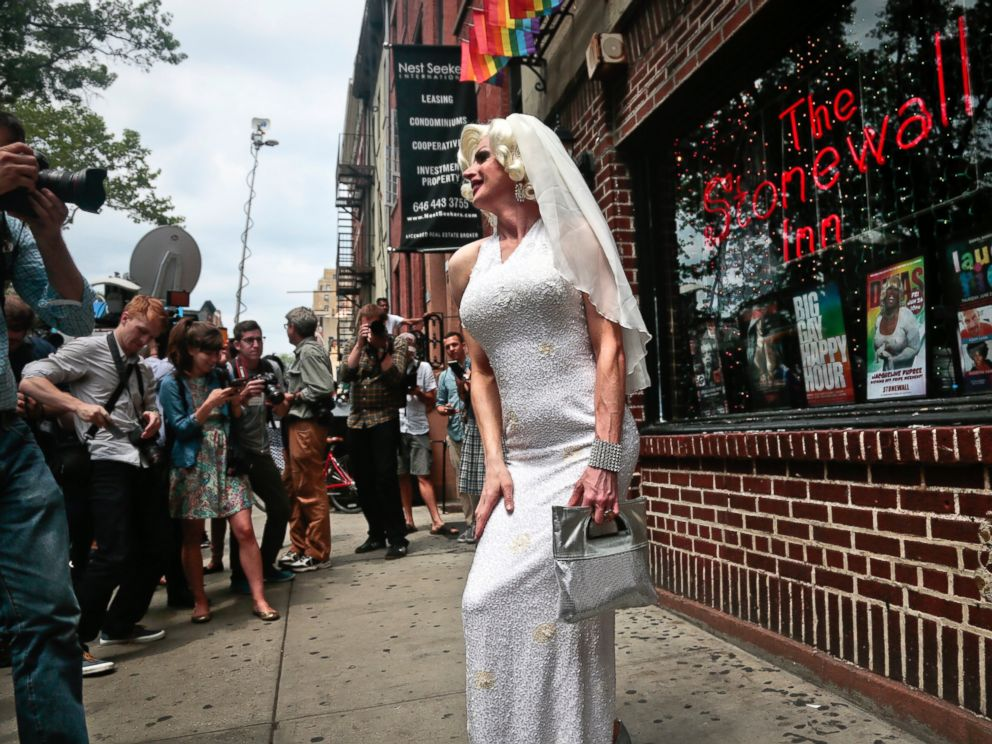 PHOTO: Carl McDonald, also known as Carllotta Gurl, pose in front of the Stonewall Inn, the iconic Greenwich Village bar credited as the birthplace of the gay rights movement, June 26, 2015, in New York.