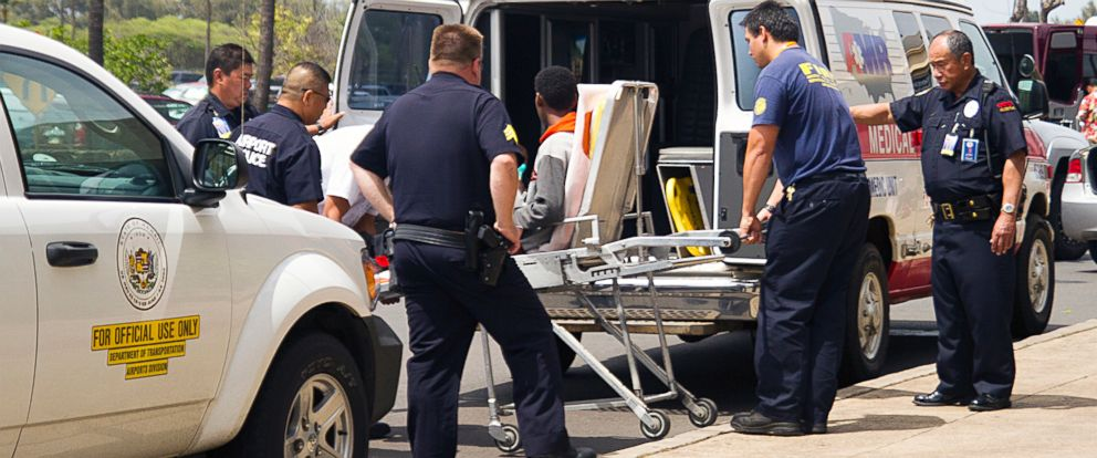 PHOTO: A 15-year-old boy, seen sitting on a stretcher center, who stowed away in the wheel well of a flight from San Jose, Calif., to Maui is loaded into an ambulance at Kahului Airport in Kahului, Maui, Hawaii, April 20, 2014.