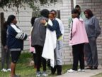 PHOTO: Family and friends console each other outside 7318 Enchanted Creek in Cypress, Texas, Sunday, Nov. 10, 2013.