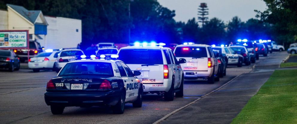 PHOTO: Lafayette Police Department and Louisiana State Police units block an entrance road following a shooting at The Grand Theatre in Lafayette, La., Thursday, July 23, 2015.