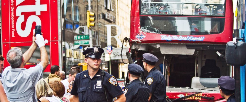 PHOTO: Police investigate the scene of a traffic accident involving two double-decker tour buses in New York Citys Theater District, Aug. 5, 2014.