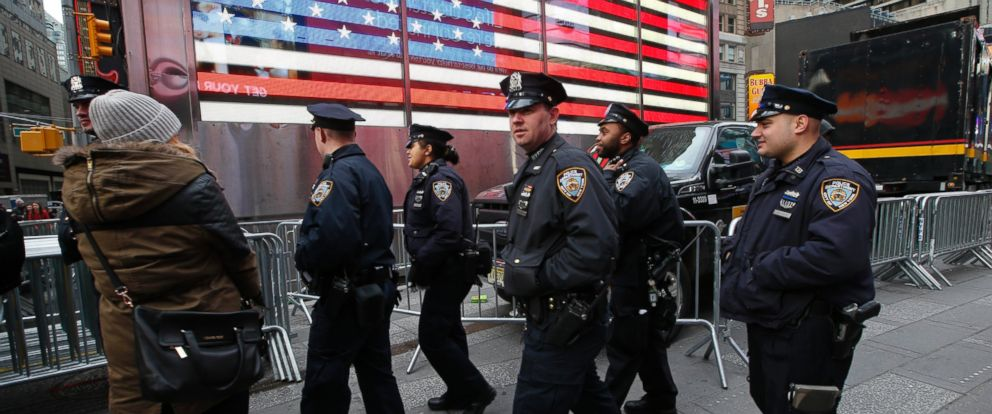 PHOTO: New York City police officers patrol in Times Square, Dec. 30, 2014, in New York.