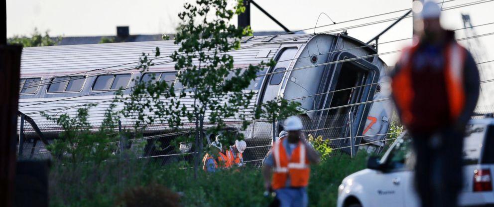 PHOTO: Emergency personnel walk near the scene of a deadly train wreck, May 13, 2015, in Philadelphia.