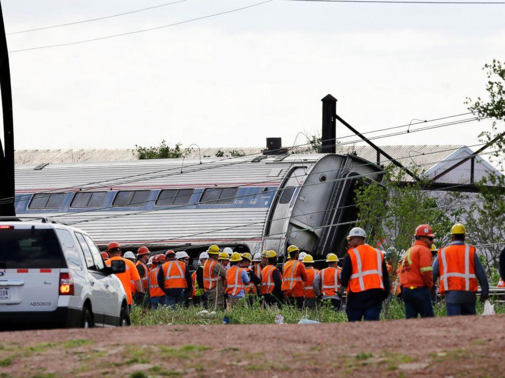 PHOTO: Emergency personnel gather near the scene of a deadly train derailment, May 13, 2015, in Philadelphia.