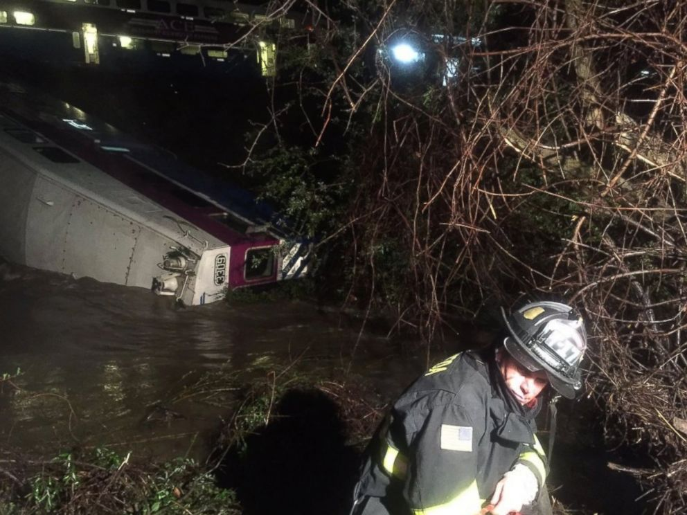 PHOTO:In this image provided the Alameda County Fire Department, first responders work the scene after a car of a commuter train plunged into Alameda Creek after the train derailed, March 7, 2016, in Alameda County, Calif.