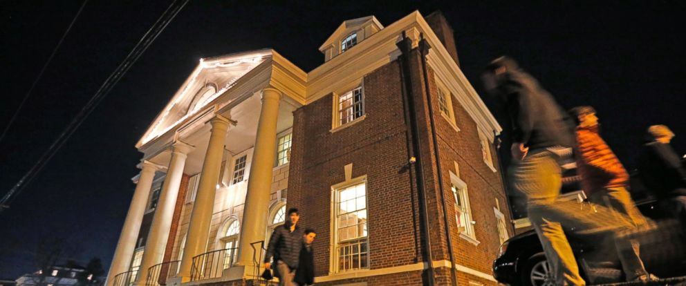PHOTO: Students walk past the Phi Kappa Psi house at the University of Virginia in Charlottesville, Virginia, Jan. 15, 2015. The house was depicted in a debunked Rolling Stone story as the site of a rape in September of 2012.